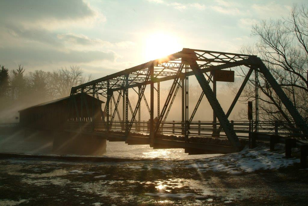 old iron bridge winter sunset